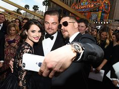 16 Random Things Stars Did on the Oscars Red Carpet | AND MORE SELFIES … | Cause really, everyone wants a selfie with Leonardo DiCaprio – even his costar Tom Hardy!