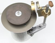 Engraver Sharpening Setup by gary hart -- Homemade engraver sharpening setup featuring a geared DC motor running at 300 RPM. Utilizes aluminum-backed diamond grinding wheels. Holding fixture permits angle adjustments to be made when sharpening. http://www.homemadetools.net/homemade-engraver-sharpening-setup
