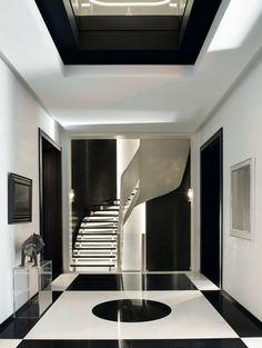 BLACK AND WHITE LUXURY DECOR| minimal decor for a luxury entryway , black an white floor | http://bocadolobo.com/ #modernentryway #entrywayideas