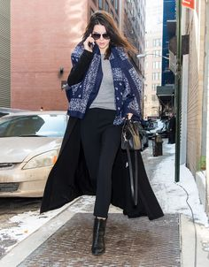 Kendall amped up her black coat with a bandana-print scarf.   - Seventeen.com