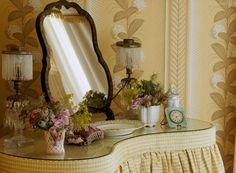 Yellow checked and gathered dressing table in an English cottage bedroom