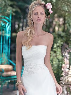 Maggie Sottero - MADGE, Decadent and indulgent, this A-line wedding dress is draped in rich Marquice organza, creating a…