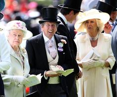 The Queen and her racing manager John Warren inspect the horses being trotted around the parade ring.   June 18, 2014