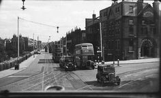 Looking down Camberwell New Road. As a child I lived straight ahead, when they took the tramlines away the workmen gave us the tar soaked wooden blocks to use on our fire. London Bus, London Street, Vintage London, Old London, Camberwell London, London Places, South London, Slums, Local History
