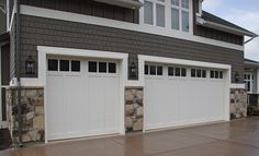 Love these simple garage doors with the gray, clean lined shakes. Not sold on th. Love these simple garage doors with the gray, clean lined shakes. Not sold on the stone that far up on the wall thou White Garage Doors, Garage Door Colors, Carriage Garage Doors, Garage Door Windows, Garage Door Styles, Garage Door Design, Barn Doors, Custom Home Builders, Custom Homes
