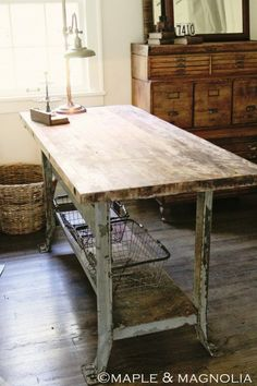 Great vintage industrial work table for craft room or kitchen island