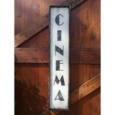 Hand painted wood sign, CINEMA.  The dimensions of the sign are approx. 35 1/4 x 7 x 1 1/2 The lettering is hand painted on rough-cut wood that has been painted and distressed and has a black distressed frame. A sawtooth hanger, firmly secured, is placed on the back for easy hanging.