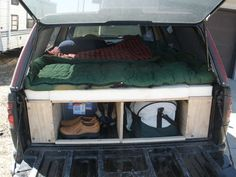 We did this, but used a 'Joey Bed' for underneath so you can slide everything all the way in the back to the front. It was awesome for 2 huge dogs and 2 adults all the way through Canada. Fun times!