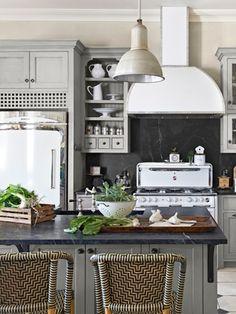 Soapstone backsplash and painted cabinets