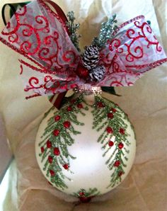 The perfect gift to bring to that holiday party or you might even just fall in love with it yourself!  Soft cream color matte ornament. One of a