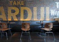 """An original painted sign for """"Cardui – A Woman's Tonic"""" on a previously exterior brick wall was maintained as an over scale art element. """"Local"""" Restaurant Dallas, Texas by Jones Baker"""