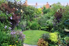 Circular lawn provides generous space for flower borders and a welcome contrast.