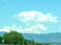 Storm clouds over Sandias.