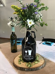 Brewery wedding Growler centerpiece with wildflowers. Hop cones, wood cross section and burlap runne Brewery Wedding Reception, Hops Wedding, Wedding Music, Wedding Table, Ski Wedding, Wedding Flowers, London Wedding, Wedding Venues, Dream Wedding