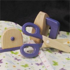 This set was actually inspired by a fellow Etsian who is sewing with her preschooler. I did that. Those were the days. Scissors move but do not cut, measuring 3in.x 7 and .75 inch thick. The iron is 4.5x2.5x3 inches and leans back on the heel just like moms. Add to the deal a 2.5x3in. tape measure with wide base and 10 inch satin ribbon tape(non retractable), and your ready for lots of productive play. These toys will build eye-hand coordination, numbers recognition, sequencing, and hours of…