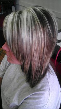 Haircolor: Dark Warm Brown Hightlights: White Blonde, Light Cool Blonde Cut: Layers, heavy face framing