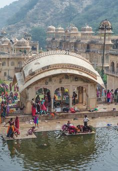 Ritual cleansing in the natural spring tank at Galwar Bagh (monkey temple), a Hindu temple complex, Jaipur, India