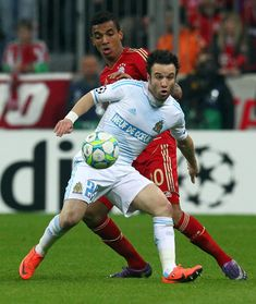 Luiz Gustavo (back) of Muenchen and Mathieu Valbuena (front) of Marseille battle for the ball during the UEFA Champions League quarter-final second leg match at Allianz Arena on April 3, 2012 in Munich, Germany.
