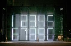 Operator by Mikko Hynninen The light installation is inspired by the aesthetics of early pocket calculators and digital watches. Dozens of fluorescent tubes create angular words written by Canadian poet and author Daniel Canty. The installation also incorporates music that can be heard outside the building.