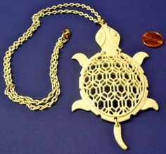 1960's White Groovy Turtle Necklace by AuntEddiesCloset on Etsy, $18.00