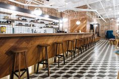 "WeWork, a popular coworking startup that leases out private offices and co-working spaces to creative freelancers and innovative tech companies across the globe, recently opened a new coworking campus in Philadelphia. ""Occupying two levels of the former Schmidt's Brewery—inspiration for the huge letters spelling ""Cheers"" behind the reception desk—this Philadelphia office space makes the most of its industrial … Continue reading A Tour of WeWork's New Coworking Space in Philadelphia →"