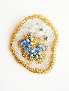 Beaded Brooch, Embroidery Brooch, Fabric Jewelry, Wearable Art  Golden seed beads form the basis of this free form beaded brooch. Pale blue freshwater