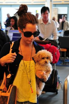 Ashley Tisdale spotted leaving Vancouver with her dog Maui