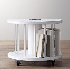 Vintage Spool Side Table - This is the cutest vintage-looking nightstand. It holds books between the spindles — how clever.