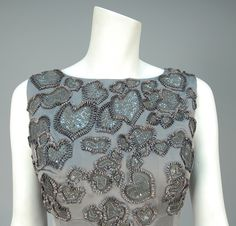Sleeveless pewter silk having empire bodice with abstract foliage design in cutwork, chiffon, raffia, sequins and tiny beads