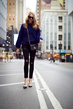 Fall Outfit, Navy Oversized Sweater, Gucci Marmont Handbag, Black Celine Sunglasses, Frame Denim Black Ripped Skinny Jeans, Valentino Rockstud Pumps