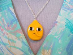 A fun Earl Of Lemongrab necklace from Adventure Time perfect to jazz up any outfit! The charm itself measures roughly 3cm x 4cm (1 inch x 1 1/2