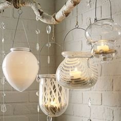 Hanging candle arrangement with repurposed jars and light globe covers