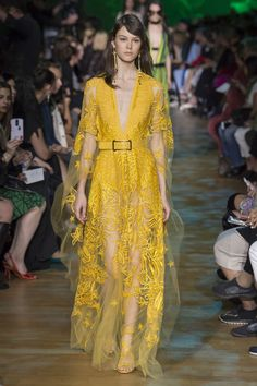 Yellow gown with embroidered floral pattern and tiny shimmering crystals - we love the sheer sleeves and skirt on this Elie Saab gown #SS18...x