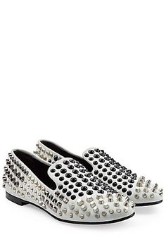 Silver-tone and gunmetal studs amp up the attitude of these white leather Giuseppe Zanotti loafers #Stylebop