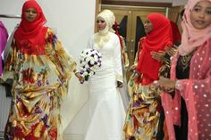 A bride from Somalia Africa wearing a western wedding dress during her wedding reception