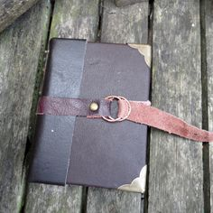 handmade brown leatherbound  journal closing by johnnythescavenger, £20.00