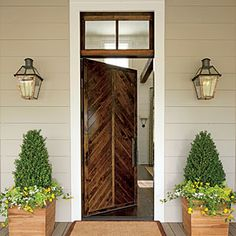 The Entryway. The chevron design of the wood door dates back centuries. Besides looking great, it's also a practical choice. The pattern keeps the door stable and sheds water to prevent warping - Nashville Idea House at Fontanel - Southern Living Cottage Patio, Southern Farmhouse, Farmhouse Decor, Southern Charm, Southern Style, Farmhouse Style, Chevron Door, Door Design, House Design