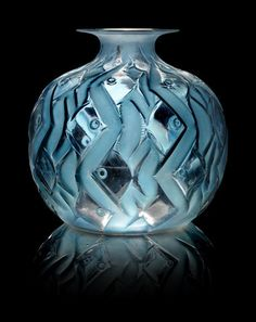 René Lalique (French, 1860-1945) 'Penthievre' a Vase, design 1928 frosted and polished glass, heightened with blue staining