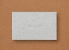 Uncoated, unbleached business card with blind deboss detail for photographer Giles Duley designed by Shaz Madani