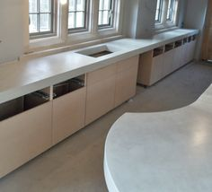 Large seamless expanses of Micro-top coated concrete  worktops .