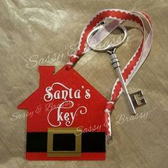 "Customized Santa's Magic Key. Order Here: http://sassybrassycustomcreations.com/products/customized-santas-key  Don't have a chimney??  That is OK!  This Magic Key will ONLY allow Santa to open the door and deliver presents, as promised.  Hang Santa's Key on the tree, like an ornament.  On Christmas Eve, hang the Magic Key on the doorknob outside.  The Red House measures 3.5"" X 3.5"" and the key is 3.5"" L"