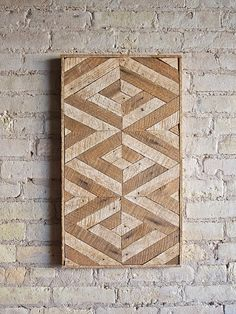 This wall piece is 15 by 27 and 1.5 deep. It can be hung from any side that you please. One of a kind design made with reclaimed wood. The wood lath used for this piece was once part of a plaster wall so one side is stained naturally by the age of the wood and the other absorbed some color from the plaster.  Made to order.  This design is copyright protected. Created by Eleventy One Studio