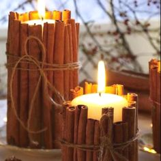 Cute DIY craft project... Cinnamon stick wrapped candles... A good tip- use a rubber band to hold sticks until you tie it
