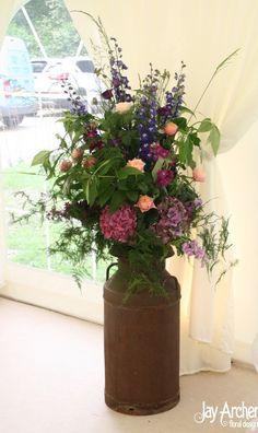Milkchurn arrangement- not these flowers or colours, but arrangement style