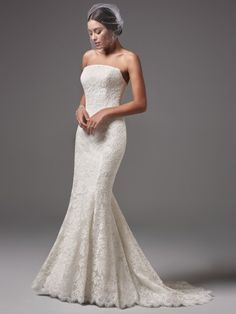 Sottero and Midgley - LINLEY, This modern and sophisticated wedding dress features floral lace motifs and a chic straight neckline and a sheath silhouette. Finished with covered buttons over zipper and inner corset closure.