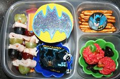 "First day of preschool lunch. ""turkey snails"" and grapes on picks. … A cheese stick…Strawberry Applesauce…raisins…Apple Rice Krispy Treats…pretzel sticks…and batman snacks!  Yep, I'm going to be one of those  Moms! :)"