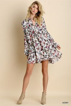 - Swing to the beat of your own drum in this beautiful flirty frock - Trapeze Style - Model is wearing a small.