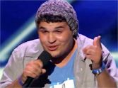 Young Boy with Tourette's Overcomes His Disabilities to Sing - and He is AWESOME.