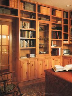 Rustic Knotty Pine Bookcases - photo via Home Plan Ideas Magazine