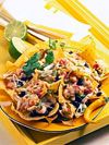 Nachos are the perfect Mexican party food, and when loaded up with meats and veggies they also make a great main course for sharing. Try variations on classic Mexican nachos for fun.